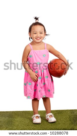 three year old toddler holding a rugby ball