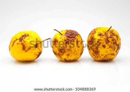 three yellow apples in a bad state