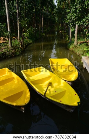 Three Yellow boat in channel at betel palm garden plot #787632034