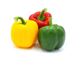Three Yellow, Red, Green Bell peppers isolated on white background.