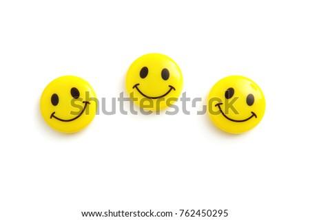 three yellow smile faces