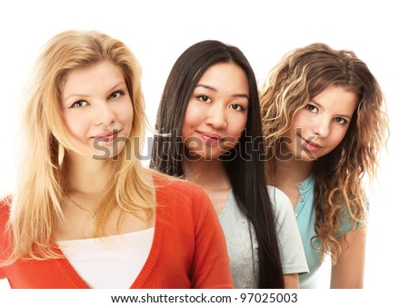 Three yong girls standing  isolated on white background