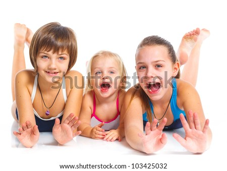 Three young beautiful sisters in swimming wear. Isolated over white background.