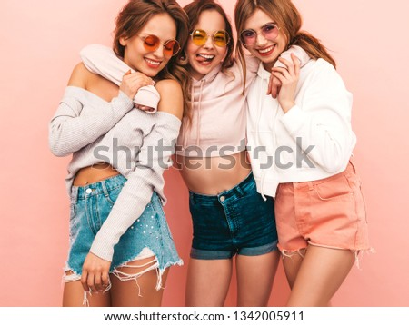 650a418d09b5a8 Three young beautiful smiling hipster girls in trendy summer hipster  clothes. Sexy carefree women posing