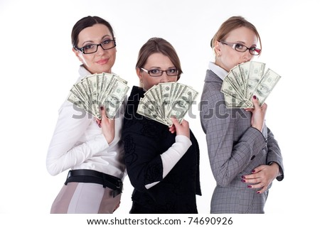 three young business woman holding a bundle of dollars. Isolated over white background