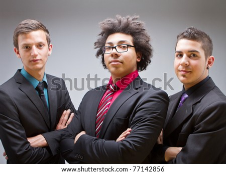 Three young businessman posing at the camera. Trendy and Cool.