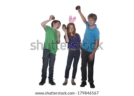 three young children playing with large chocolate easter eggs
