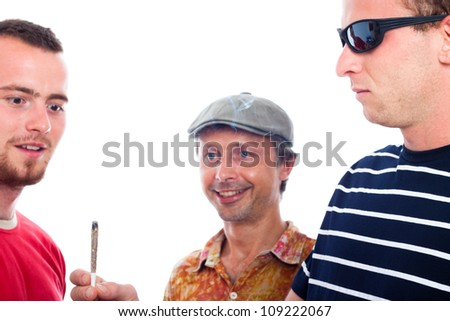 Three young excited guys sharing hashish joint, isolated on white background.