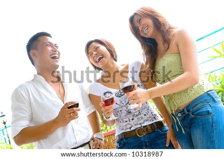 Three young friends enjoying time socializing together.