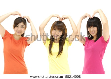 Three young friends standing together having fun - stock photo