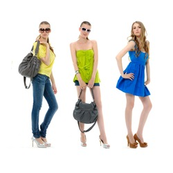 three young girl in summer dress in sunglasses and with bag posing