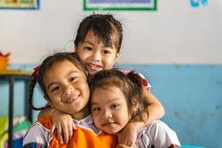 Three young girls girlfriends in a thai school. Thai school in a small village