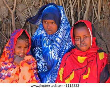 Three young girls with traditional dresses in the Somali region of eastern Ethiopia