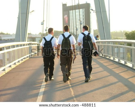 three young mormons walking on the bridge