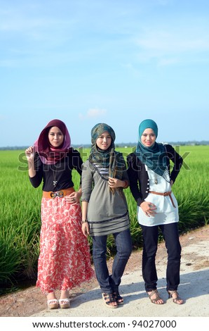 three young pretty Asian muslim college girl happy together - stock photo