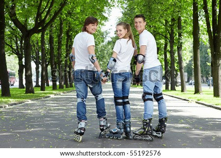 Three young scooters stand having turned back in park