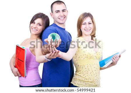 three young smiling students with books holding globe - stock photo
