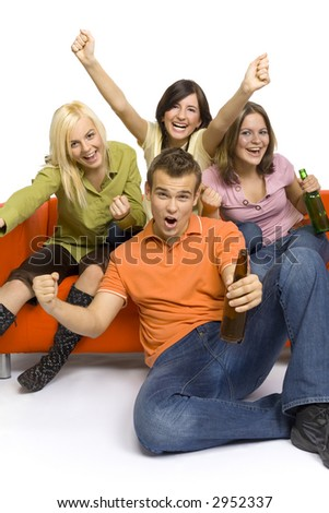 Three young woman and a man are sitting on (and next to) the orange couch. Two of them are holding beer. They're shouting and gesturing.