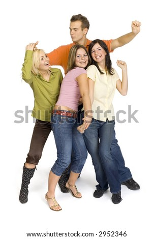 Three young woman and a man are standing on the white background in the studio. They're dancing. Whole the bodies are visable. - stock photo