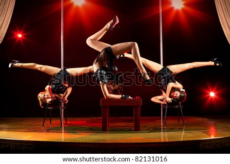 Three young women acrobatic show.