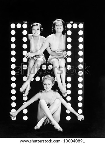 Three young women posing with the letter H