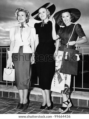 Three young women standing side by side and smiling Zdjęcia stock ©