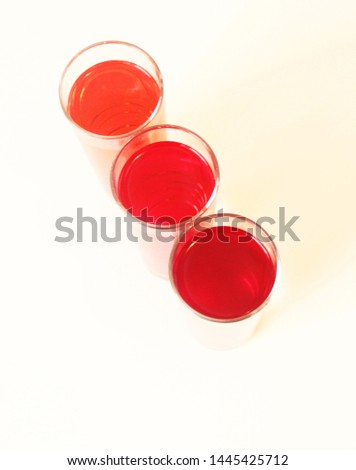 Threee Glasses of red liquid on white background, São Paulo, Brazil #1445425712