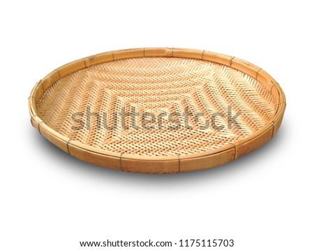 Threshing basket isolated on white background. Threshing basket made from bamboo strip. Threshing basket use for rice winnowing and threshing.
