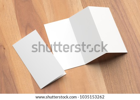 Thrifold - Three fold brochure mock up on wooden background. 3d illustrating