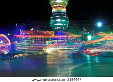 Thrill ride at a funfair at night - stock photo