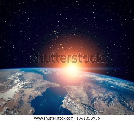Thrilling sunrise from space. The elements of this image furnished by NASA.