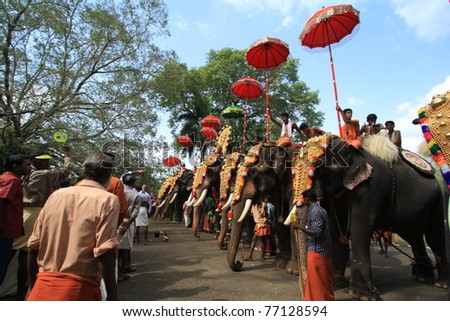 THRISSUR, INDIA - MAY 12 : Decorated elephants stand in line for procession at Elephant Festival on May 12, 201 in Thrissur, India. Thrissur Pooram is the most popular elephant festival in India. - stock photo