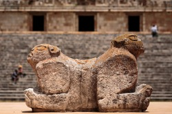 Throne of the two-headed jaguar. In the background is the Palacio del Gobernador or Governor's Palace, in the Ancient Mayan city of Uxmal, Yucatán, Mexico. Horizontal view