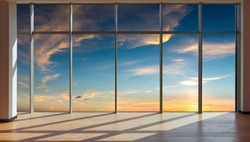 Through the floor-to-ceiling windows, the outdoor sky and cloudscape