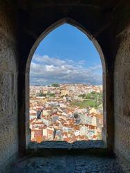 Through the window of time admiring Lisbon