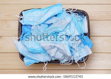 Throw Away Used Mask. Discarded surgical masks. Trash Bin with Medical Waste. Mask to the Trash Can. Medical Mask After Use. Used Masks. Waste Bin with Masks. Infected Waste. End of Pandemic. Covid 19 Stock photo ©