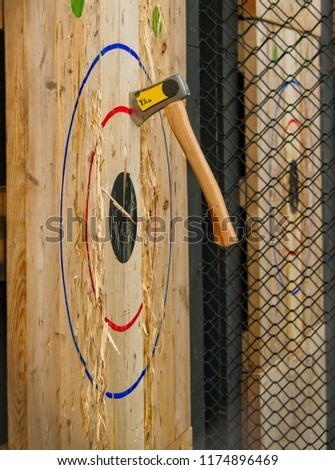 Throwing Axe Embedded In A Target