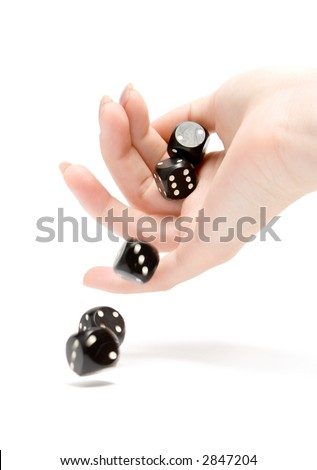 Throwing black gambling dices isolated on white
