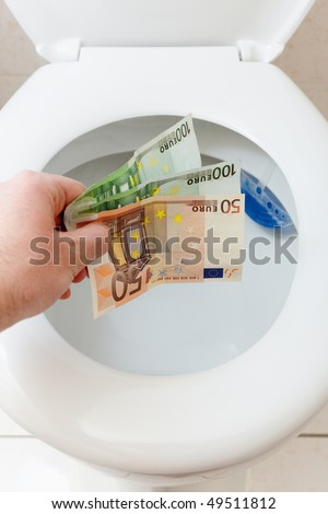 throwing euro money in a toilet bowl