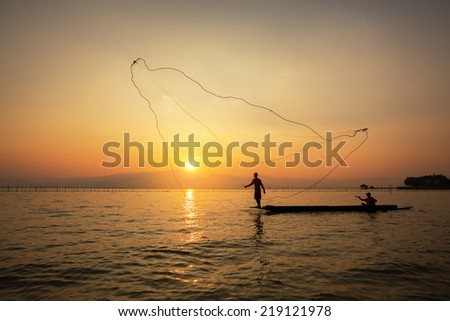 throwing fishing net during sunset , thai #219121978