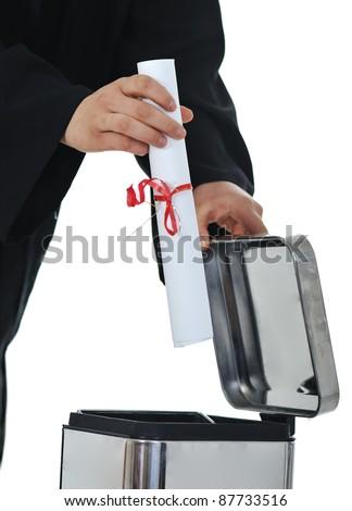 Throwing graduate diploma in trash, conceptual image