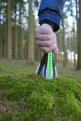 Throwing knives   in hand on forest background. Throwing knives close-up in a mossy stump.Outdoor sports. Knife throwing sport.Active sports in the forest.Sport and hobby.
