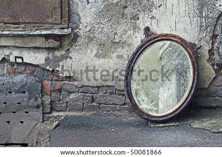 Thrown Out Old Mirror Standing Against Wall