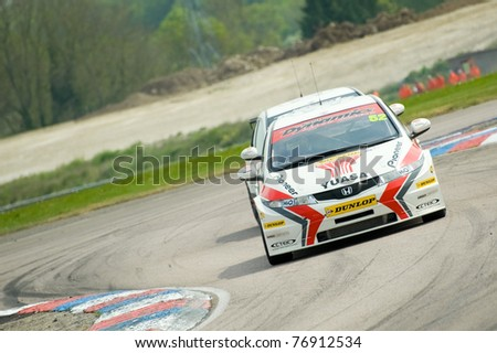THRUXTON, UNITED KINGDOM - MAY 1: Honda Racing driver Gordon Shedden with team-mate Matt Neal in his slipstream at the British Touring Car Championships on May 1, 2011 in Thruxton, UK.