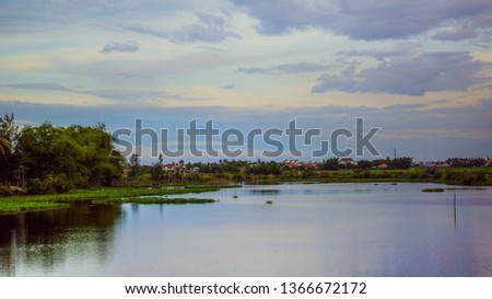 Thu Bon River at sunset in Hoi An, Vietnam. Hoi An is the World's Cultural heritage site, famous for mixed cultures and architecture #1366672172