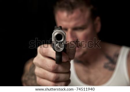Thug Pointing a Gun