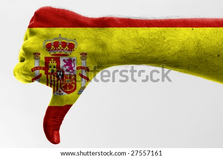 thumb down with digitally body-painted spanish flag