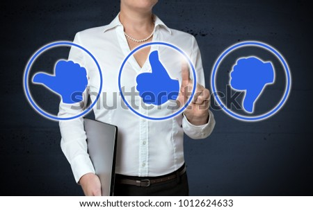 Thumb icons touchscreen shown by businesswoman.
