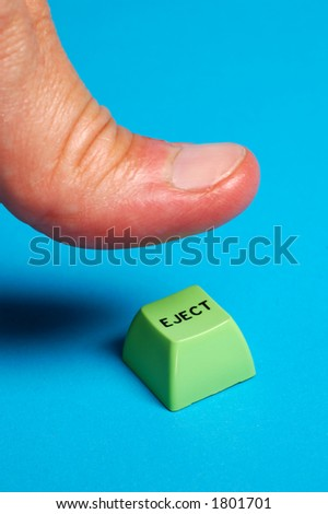 thumb pushing green ejection button - stock photo