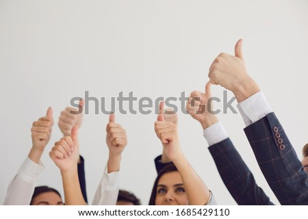 Thumb up. Group of people hold thumb up congratulations on a white background.